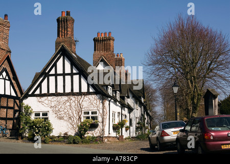 UK Cheshire Vale Royal Great Budworth School Lane cottages beside St Marys Parish church - Stock Photo