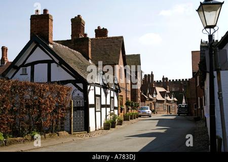 UK Cheshire Vale Royal Great Budworth village main street and Saint Marys Parish church - Stock Photo