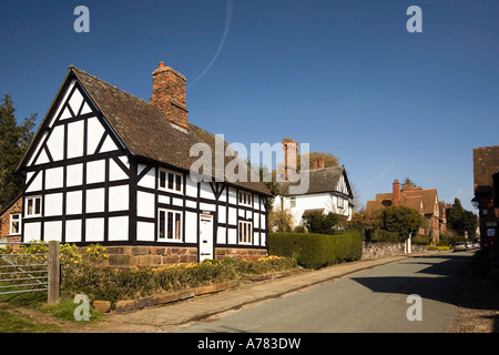 UK Cheshire Vale Royal Great Budworth old timber framed cottage in village main street - Stock Photo