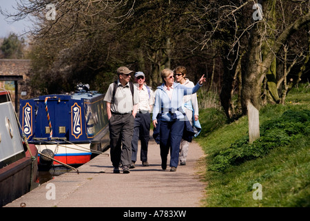 UK Cheshire Vale Royal Northwich Anderton Trent and Mersey Canal walkers on towpath - Stock Photo