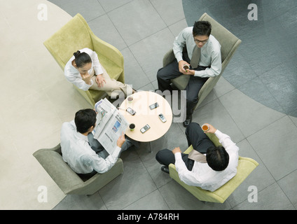 Executives sitting in lobby, view from directly above - Stock Photo
