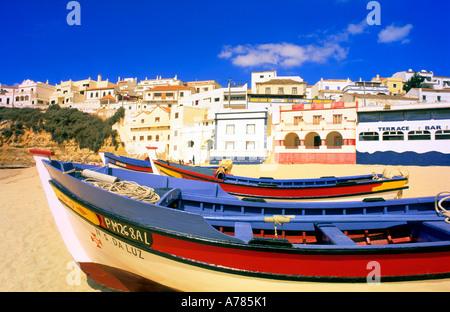 Boats lying at the bay of Carvoeiro Lagoa Algarve Portugal - Stock Photo