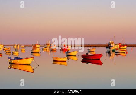 Boats anchoring at the Ria Formosa, Santa Luzia, Tavira, Algarve, Portugal - Stock Photo