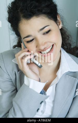 Businesswoman using cell phone, portrait - Stock Photo