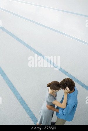 Young couple embracing, high angle view - Stock Photo