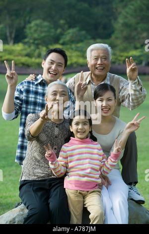 Three generation family in park, portrait