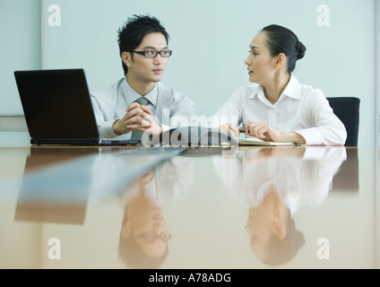 Business executives working in conference room - Stock Photo