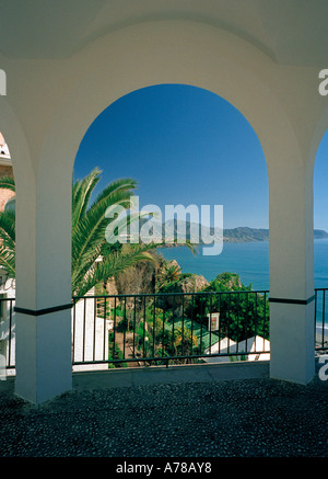 A palm tree and the coastline, framed by arches on the Balcon de Europa,at Nerja on the Costa del Sol, Andalusia, - Stock Photo