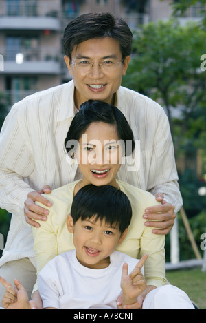 Family, smiling at camera, portrait - Stock Photo