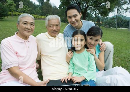 Three generation family, smiling at camera