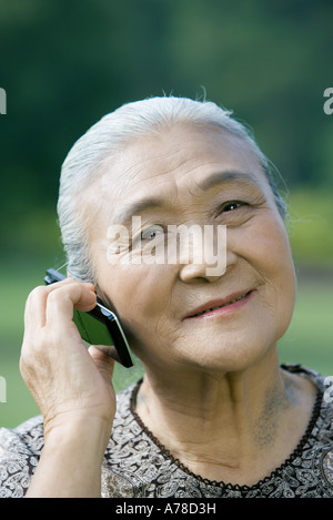 Senior woman using cell phone - Stock Photo