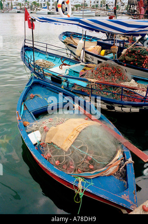 Small fishing boats in the harbour of Port Al Kantouai, near Sousse, Tunisia - Stock Photo