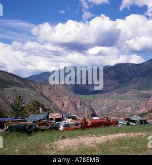 A car dump in the remote mountainous landscape near Pavilion, Lillooet, British Columbia, Canada KATHY DEWITT - Stock Photo