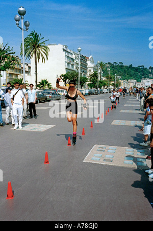 Rollerblading  on the Promenade des Anglais, Nice, on the Cote d'Azur, French Riviera, France - Stock Photo