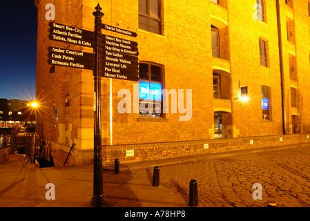 Blue bar and tourist sign Albert Dock at Night - Stock Photo