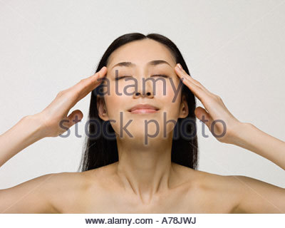 Young woman touching face - Stock Photo