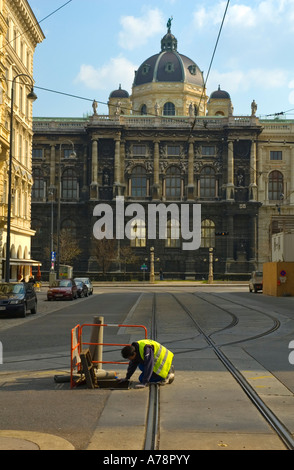 A city maintenance worker in central Vienna Austria with Natural History Museum in the background - Stock Photo