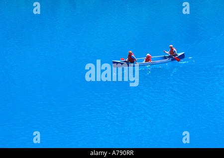 Family in canoe on Moraine Lake Banff National Park - Stock Photo