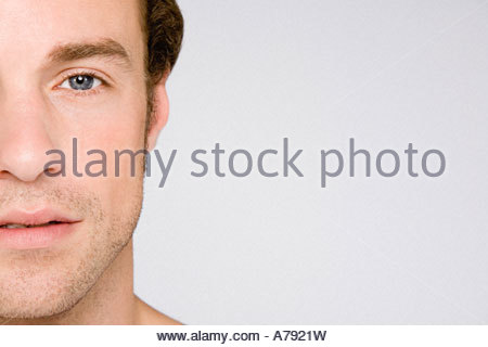 Cropped portrait of a young man - Stock Photo