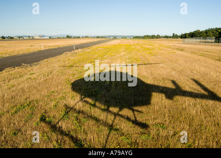 Aerial Image of a helicopter taking off from Victoria International Airport - Stock Photo