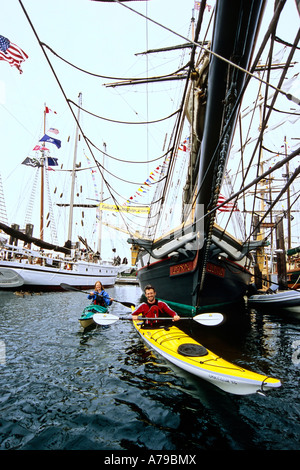 Kayaking during the annual Tall Ships Festival in the Victoria Harbour British Columbia Canada - Stock Photo