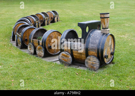 Upcycled wooden toy train engine & carriages; Garden furniture made from Whisky barrels at Speyside cooperage Dufftown, - Stock Photo