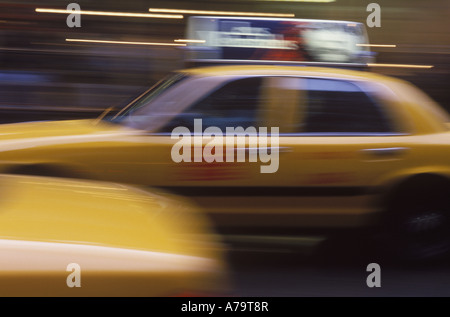 Moving taxi in traffic - Stock Photo