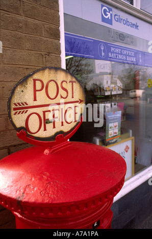 Cheshire Stockport Woodford Post Office sign on top of post box - Stock Photo