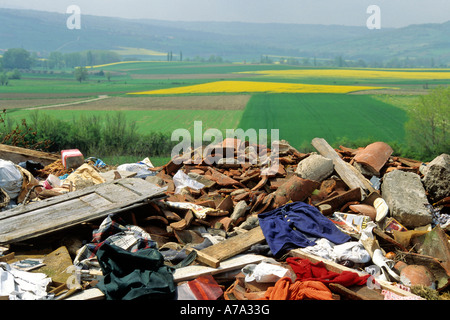 Rubbish tip / landfill site in the countryside - Stock Photo