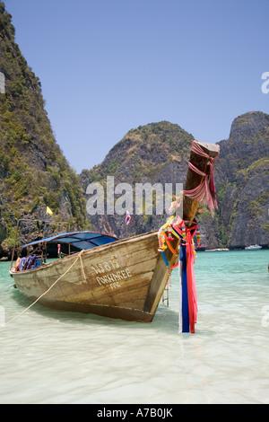 Prows of longtail boats, close ups of  long tailed boat, with Buddhist garlands, Ko Phi-Phi Don island, Maya Bay, - Stock Photo