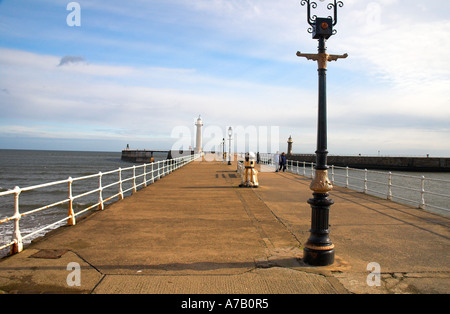 A view along Whitby west pier - Stock Photo