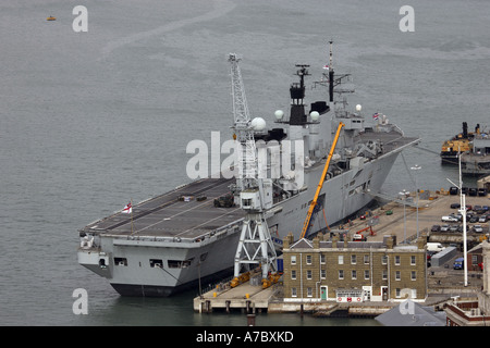 Royal Navy Aircraft Carrier HMS Illustrious sitting at its berth in Portmouth Naval Yard Portsmouth Harbour - Stock Photo