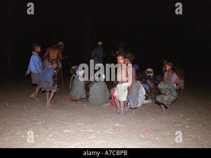 San Bushmen Dancing village in night Botswana - Stock Photo