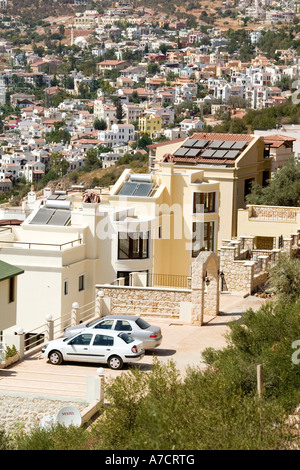 apartments with solar panels Kalkan southern Turkey on Mediterranean coast - Stock Photo