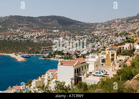 New apartments each with solar panels with the town of Kalkan behind on the Mediteranean coast near Fethiye - Stock Photo