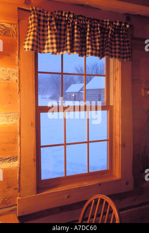 View of snowy scene through cabin window Galena Illinois - Stock Photo