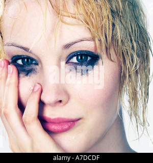PRETTY BLOND WITH WET HAIR AND MAKE UP - Stock Photo