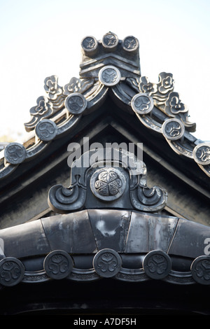 Decorative carved wooden detail and hongawara roof tiles on toshu go shrine in Nanzenji Konchi in temple city of - Stock Photo