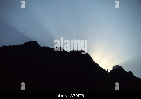 The sun rises over the Col de Bavella in the mountains of Corsica - Stock Photo