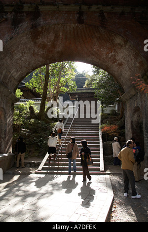 People and visitors walking around arched viaduct in Nanzenji temple city of Kyoto Japan Asia Historic structure - Stock Photo