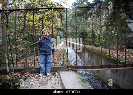 Young western boy child beside viaduct in Nanzenji temple city of Kyoto Japan Asia - Stock Photo