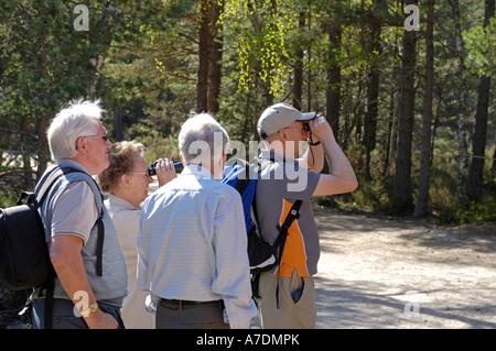 Bird Watchers exploring woodlands near Aviemore in the scottish Highlands.  XPE 6360 - Stock Photo