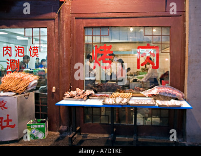 CHINA XI'AN Various meats and seafood on display outside kabob restaurant in the Muslim Quarter of old Xi'an - Stock Photo