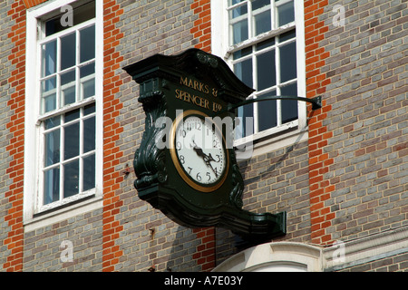 Marks and Spencer shop. Newbury Berkshire England UK. Clock - Stock Photo