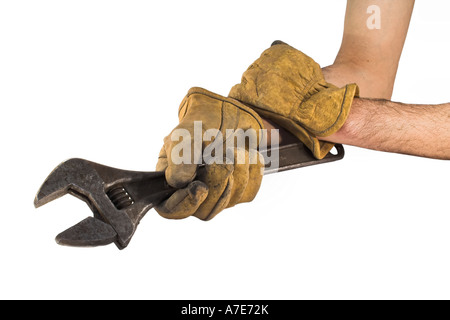 Man holding wrench with leather gloves - Stock Photo