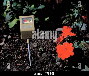 Soil pH meter registering an acid soil - Stock Photo