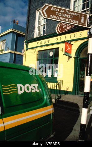 An Post Irish Post Office sign on side of delivery van parked outside Kinsale Post Office - Stock Photo