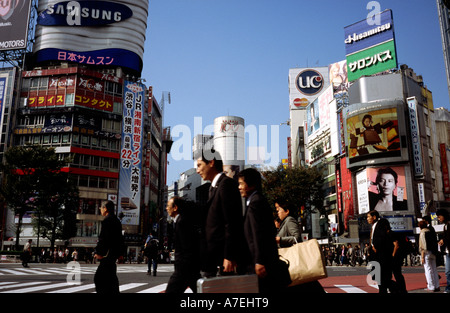 People cross what is reportedly the world's busiest scramble crossing in central Tokyo's Shibuya in Japan. - Stock Photo