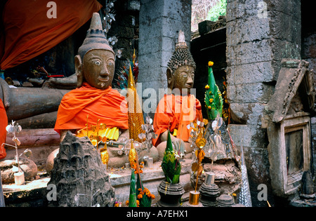 Feb 18, 2003 - Buddhas still dressed up a couple of days after Magha Puja (Full Moon Festival) at Wat Phou in Laos. - Stock Photo