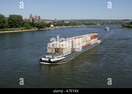 Containership on the river rhine in front of castle Ehrenbreitstein. Koblenz, Rhineland-Palatinate, Germany. - Stock Photo